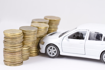 White sports toy car crashes into a wall of money