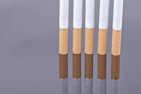 reflectivity: Cigarette on a reflective surface