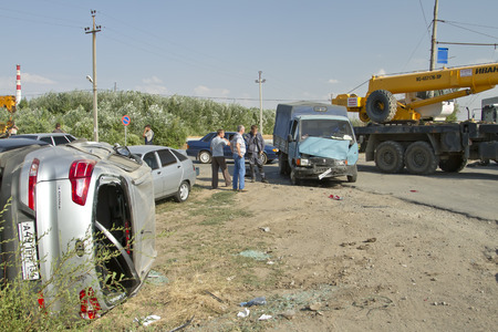 exceeding: VOLGOGRAD - AUGUST 21: A traffic accident involving tractor Belarus, truck Gazelle and crossover Kia Sportage exceeding the speed limit. August 21, 2014 in Volgograd, Russia.