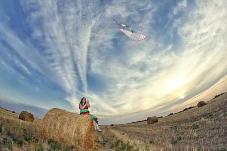 haymow: Young pregnant woman starts flying serpent in the field
