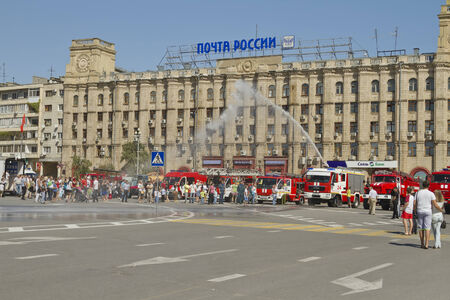 water jet: VOLGOGRAD - SEPTEMBER 6: Fire engines at the exhibition under the open sky demonstrate the possibility of a fire hose. September 6,water jet 2014 in Volgograd, Russia.