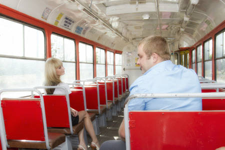 cute guy: young guy to get acquainted with a cute girl in the tram.