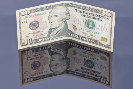 reflectivity: banknote one dollar on a reflective surface Stock Photo