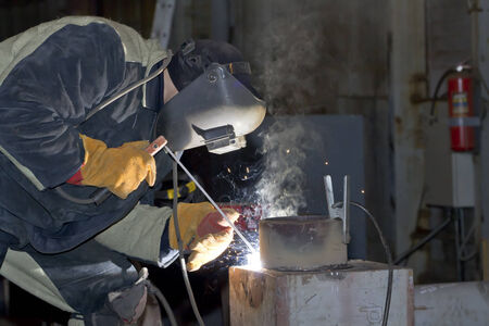 Welder working on welding of shells heat exchanger photo