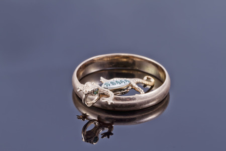 Unusual gold pendant in the form of salamanders in the Golden ring Stock Photo