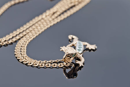 Unusual gold pendant in the form of a lizard photo