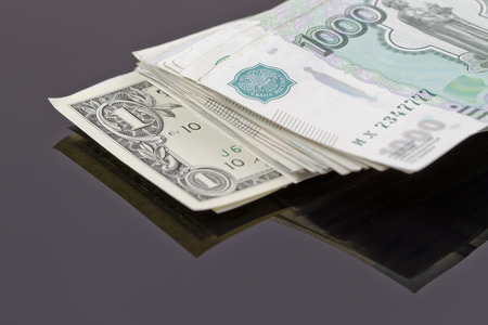 reflectivity: stack of Russian rubles and one dollar