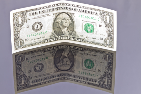reflectivity: Banknote one dollar with your own reflection
