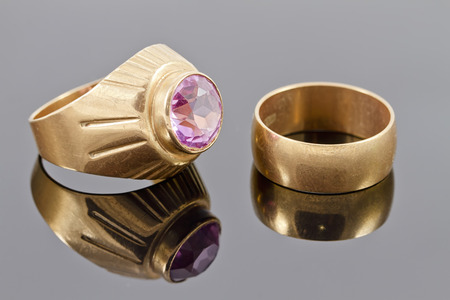 signet: gold ring with a precious stone and old broad engagement ring