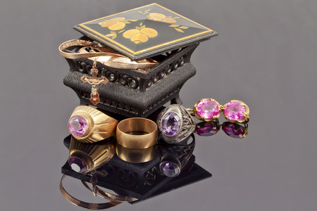 reflectance: Small jewellery box with rings, chain and cross
