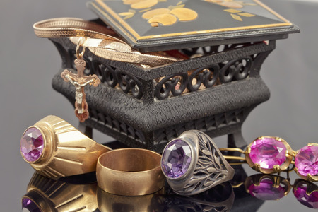 Small jewellery box with rings, chain and cross photo