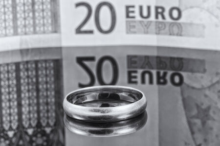 reflectivity: Gold ring on background of Euro banknotes with reflection Stock Photo