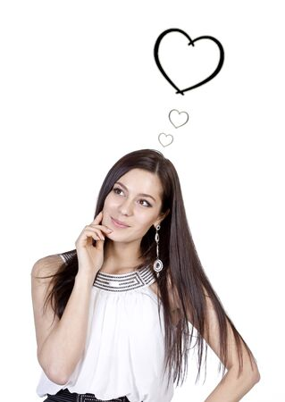 Beautiful dark-haired girl with long hair thinking about love Stock Photo