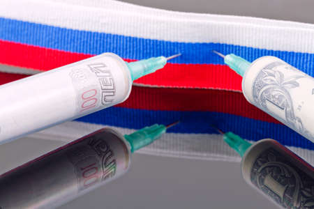 pierce: Syringes with dollars and roubles pierce the ribbon of the Russian flag