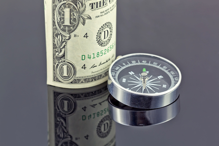 reflectivity: dollar bill and compass are on the surface