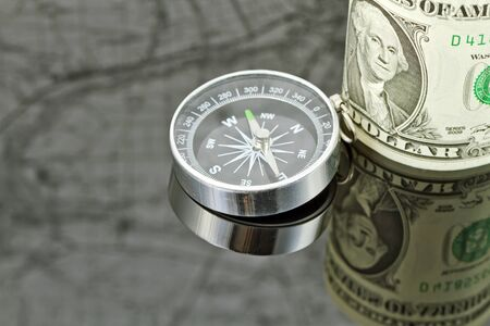 reflectivity: dollar bill and compass are on the surface which reflects map