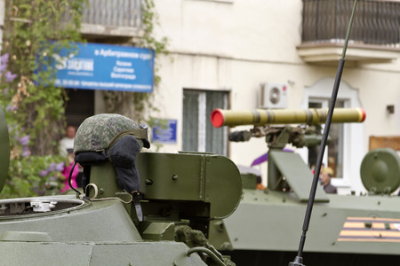 convoy: VOLGOGRAD - MAY 9: tanker helmet hanging on the hatch infantry fighting vehicle standing in the convoy of military vehicles on parade. May 9, 2015 in Volgograd, Russia. Editorial