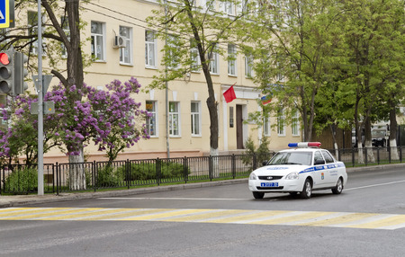the traffic movement police: VOLGOGRAD MAY 9: A police cruiser outside World at the Planetarium blocking traffic for the safe conduct of the parade. May September 2015 in Volgograd Russia.