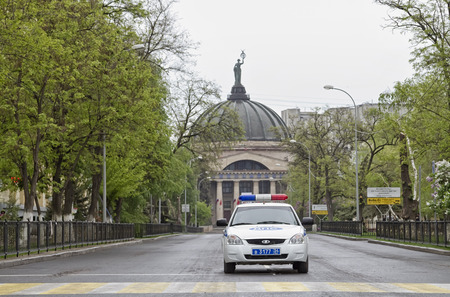 encirclement: VOLGOGRAD MAY 9: A police cruiser outside World at the Planetarium blocking traffic for the safe conduct of the parade. May September 2015 in Volgograd Russia.