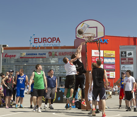 dank: VOLGOGRAD, RUSSIA - MAY 24: Unidentified young people play in streetball on the open area located next to the dancing bridge. Annual streetball party organized Europa city Mall, on May 24, 2015 in Volgograd, Russia.