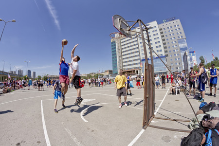 dank: VOLGOGRAD, RUSSIA - MAY 24: A throw from an average distance covering defender. Annual streetball party organized Europa city Mall, on May 24, 2015 in Volgograd, Russia.