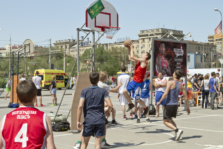 dank: VOLGOGRAD, RUSSIA - MAY 24: The one-on-one with the ring after a good combination. Annual streetball party organized Europa city Mall, on May 24, 2015 in Volgograd, Russia. Editorial