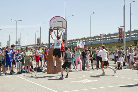 dank: VOLGOGRAD, RUSSIA - MAY 24: shot from under the basket after a good combination. Annual streetball party organized Europa city Mall, on May 24, 2015 in Volgograd, Russia.