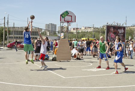 dank: VOLGOGRAD, RUSSIA - MAY 24: A throw from an average distance on streetball Playground. Annual streetball party organized Europa city Mall, on May 24, 2015 in Volgograd, Russia.