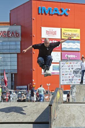 rollerskating: VOLGOGRAD - MAY 24: Sportsman roller performs basic trick jump. The fifth annual competition for the Cup of Europe city Mall . May 24, 2015 in Volgograd, Russia.