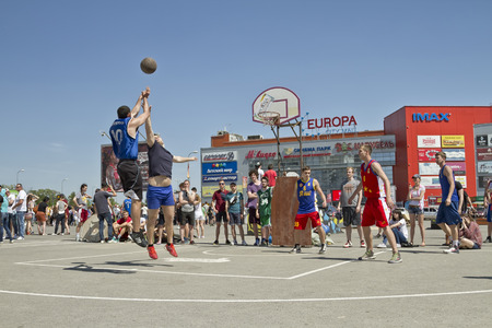 dank: VOLGOGRAD, RUSSIA - MAY 24: throw from an average distance through a defenders hands. Annual streetball party organized Europa city Mall, on May 24, 2015 in Volgograd, Russia.
