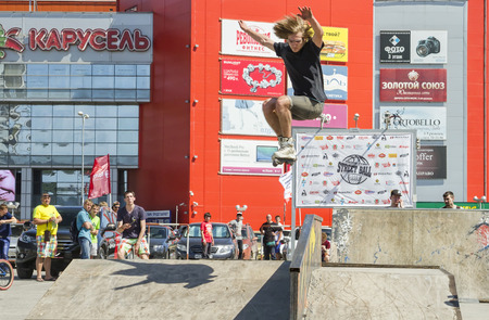 rollerskater: VOLGOGRAD - MAY 24: Sportsman roller performs basic trick jump. The fifth annual competition for the Cup of Europe city Mall . May 24, 2015 in Volgograd, Russia.