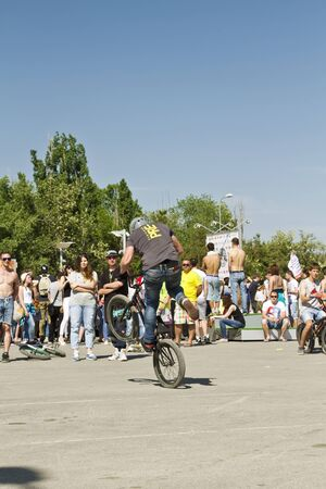 bmx bike: VOLGOGRAD - MAY 24: The athlete is an extreme sports enthusiast performs a trick on a BMX bike with a rotation on the rear wheel. The fifth annual competition for the Cup of Europe city Mall . May 24, 2015 in Volgograd, Russia.