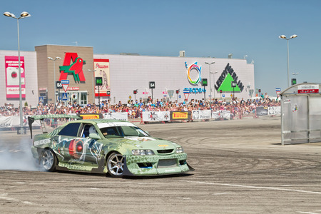slew: VOLGOGRAD - JUNE 6: Drift car team X-Round enters the bend with slip during demonstrations as part of the tour on cities of Russia Thank you for the victory!. June 6, 2015 in Volgograd, Russia.