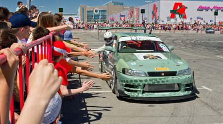 croud: VOLGOGRAD JUNE 6: pilot of drift team XRound welcomes visitors who came to the show