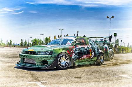 drifting: VOLGOGRAD - JUNE 6: Specially designed for drifting machine stylized military themes during a speech at the auto show. June 6, 2015 in Volgograd, Russia. Editorial