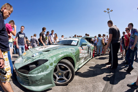 VOLGOGRAD - JUNE 6: The audience drift show with interest in visiting powerful cars designed specifically for drifting. June 6, 2015 in Volgograd, Russia. Editorial