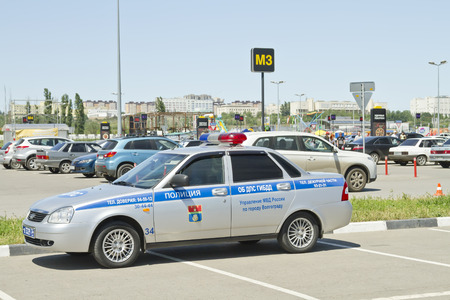 VOLGOGRAD JUNE 6: Patrol police car parked in the Parking lot in violation of the rules. June June 2015 in Volgograd Russia. Editorial
