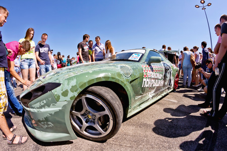 pirelli: VOLGOGRAD - JUNE 6: The audience drift show with interest in visiting powerful cars designed specifically for drifting. June 6, 2015 in Volgograd, Russia. Editorial