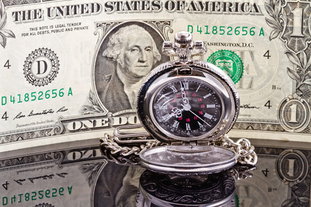 Pocket watch where the arrows show 8-00 and the dolla