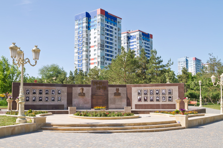 urbanite: VOLGOGRAD RUSSIA MAY 24: Hall of fame defenders installed at the entrance to the Park of friendship VolgogradBaku on the background highrise buildings. May 24 2015 in Volgograd Russia.