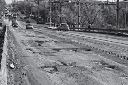 pits: VOLGOGRAD - FEBRUARY 22: Terrible pavement or the lifting bridge. All asphalt in the pits. February 22, 2014 in Volgograd, Russia. Editorial