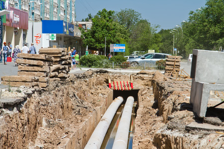sewerage: VOLGOGRAD, RUSSIA - JULY 4: Repair work on the pipeline water supply, Sewerage and heating in the middle of a residential area. July 4, 2015 in Volgograd, Russia.