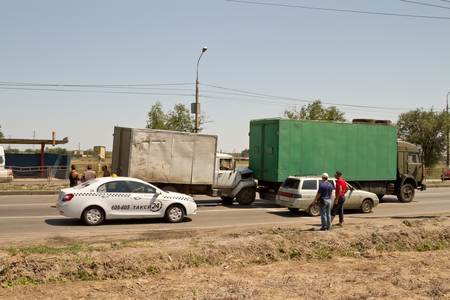 involving: VOLGOGRAD - JULY 7: Traffic accident on the road involving old commercial trucks.  July 7, 2015 in Volgograd, Russia.