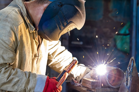 A worker welds a sample to confirm their skills