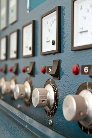 breakers: Instrument panel with circuit breakers and switches to control complex industrial installation Stock Photo