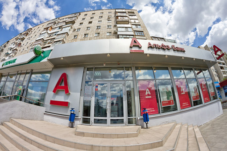 alfa: VOLGOGRAD, RUSSIA - JULY 13: A branch of Alfa Bank and Sberbank of Russia located on the ground floor of the apartment house. July 13, 2015 in Volgograd, Russia.