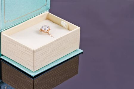 precious stone: A gold ring with a precious stone in a gift box in the form of books Stock Photo