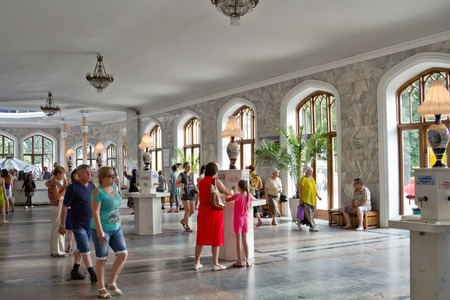 crowd source: KISLOVODSK - AUGUST 6: Tourists in Narzan gallery of Kislovodsk try mineral water from different sources . August 6, 2015 in Kislovodsk, Russia.