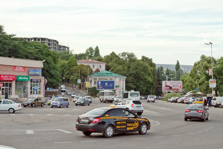 sectoring: KISLOVODSK - AUGUST 6: Taxi at the roundabout road junction in the centre of the city. August 6, 2015 in Kislovodsk, Russia. Editorial