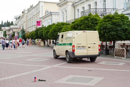 green plastic soldiers: KISLOVODSK - AUGUST 6: ollection service auto of the savings Bank of Russia on the city square in the background crawling toy soldier. August 6, 2015, in Kislovodsk, Russia. Editorial